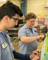 Auto Collision Students Working on Car